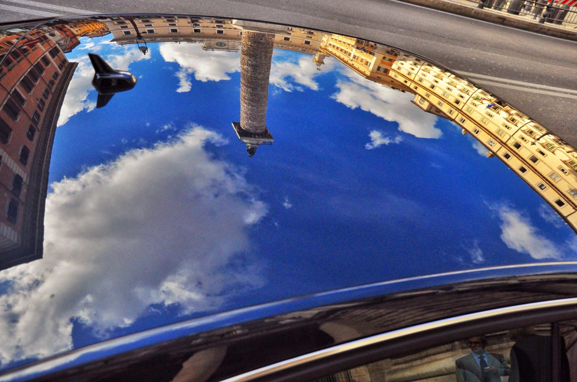 Reflex on blu car - Chigi palace - Rome - Italy